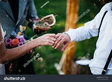 Newlyweds Exchange Rings On Registration Marriage Stock