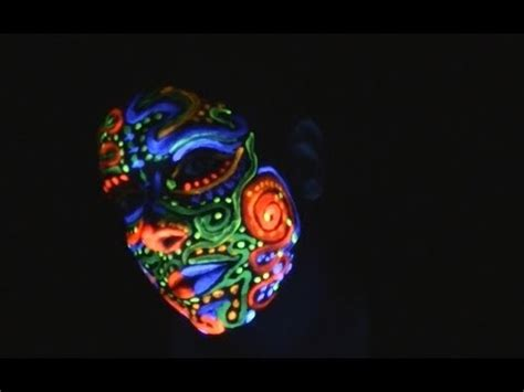 Face Painting With Fluorescent Paint Under A Blacklight